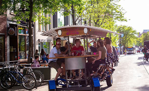 Trolley pub with a group of people on a city street